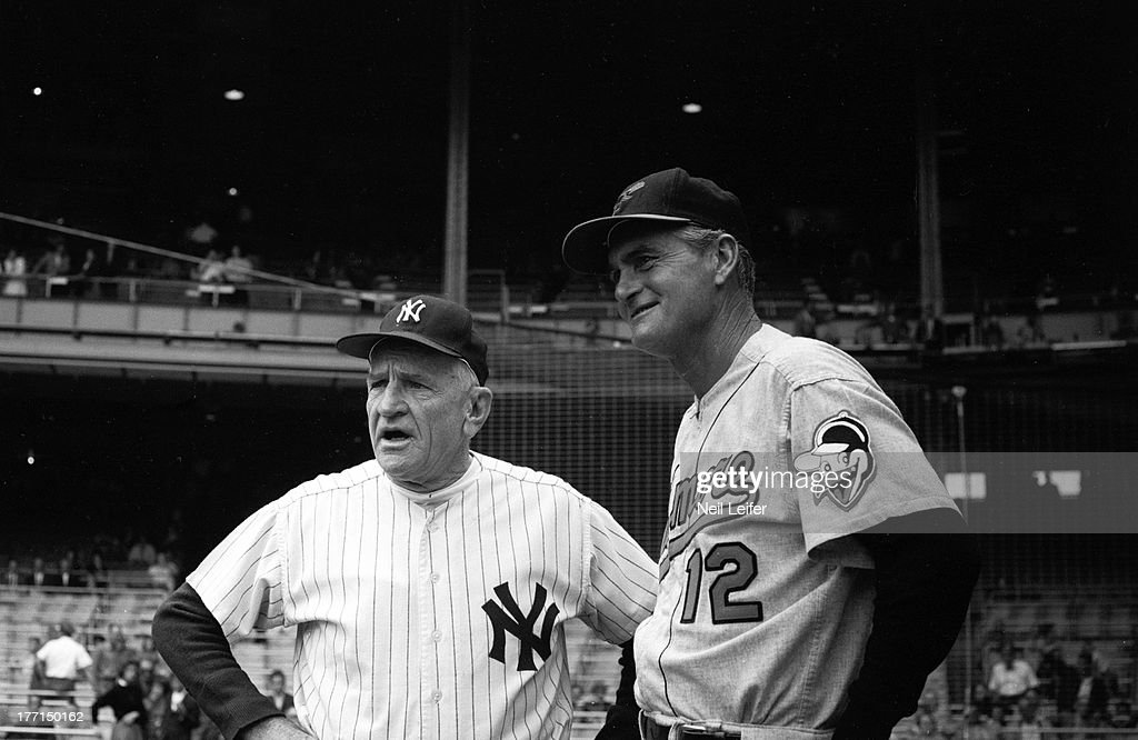 New York Yankees manager Casey Stengel (37) and Baltimore Orioles manager Paul Richards (12) on field before game at Yankee Stadium. Neil Leifer F19 )