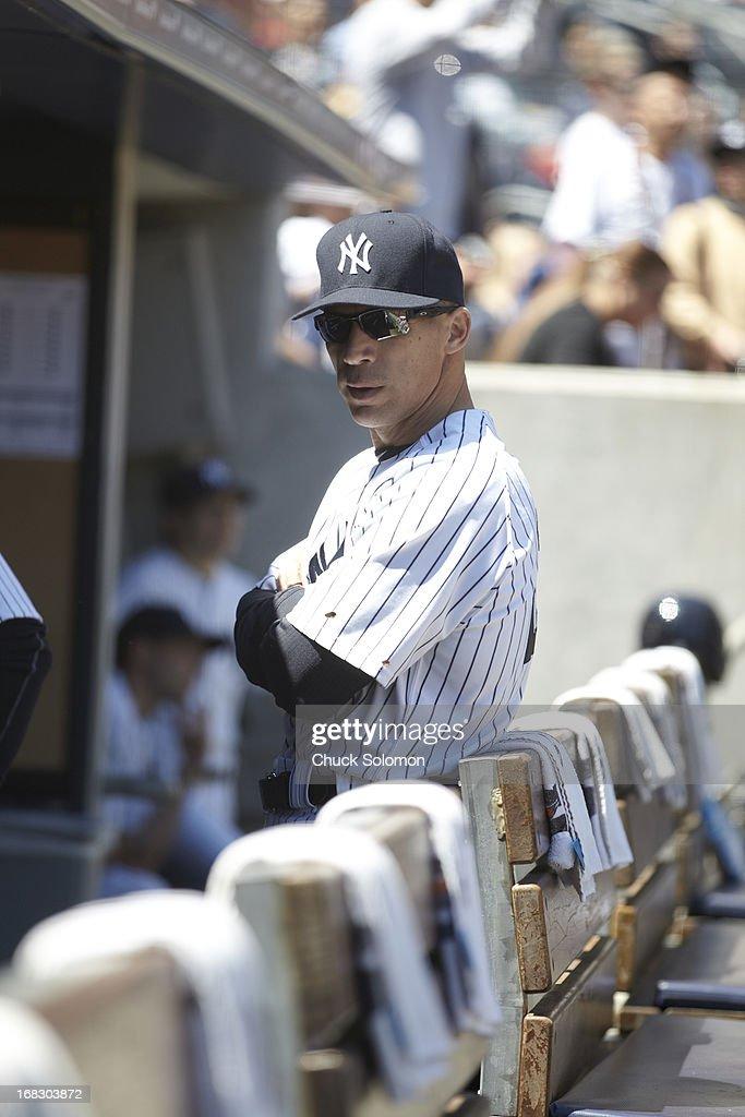 New York Yankees manager Joe Girardi (28) in dugout during game vs Oakland Athletics at Yankee Stadium. Chuck Solomon F13 )