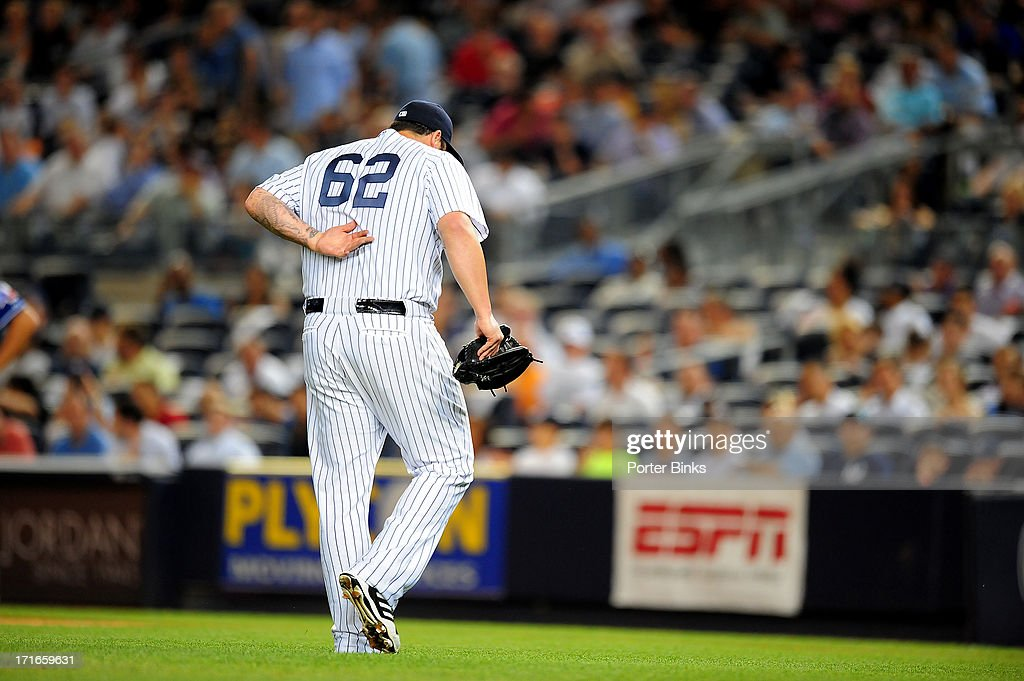 New York Yankees relief pitcher Joba Chamberlain (62) leaves the game after giving up two runs in the 7th inning during game vs Texas Rangers at Yankee Stadium. Porter Binks TK1 )