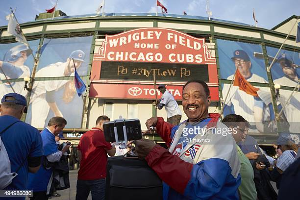 NLCS Playoffs Chicago Cubs fan taking selfie picture outside of Wrigley Field before game vs New York Mets Game 4 Chicago IL CREDIT Jeff Haynes