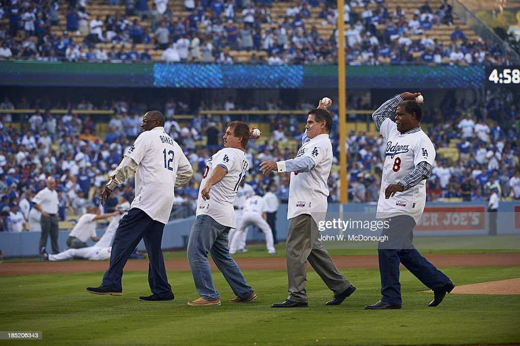 Former Los Angeles Dodgers (L-R) Dusty Baker, Ron Cey, Steve Garvey, and Reggie Smith throwing out ceremonial first pitch before game vs St. Louis Cardinals at Dodger Stadium. Game 3. John W. McDonough F47 )
