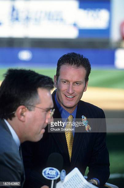 NLCS Playoffs Fox Sports announcer Steve Lyons wearing ribbon for autism awareness before New York Mets vs St Louis Cardinals game at Shea Stadium...