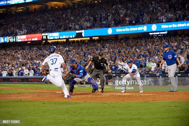 NLCS Playoffs Los Angeles Dodgers Charlie Culberson in action scoring run vs Chicago Cubs Willson Contreras at Dodger Stadium Game 1 Los Angeles CA...
