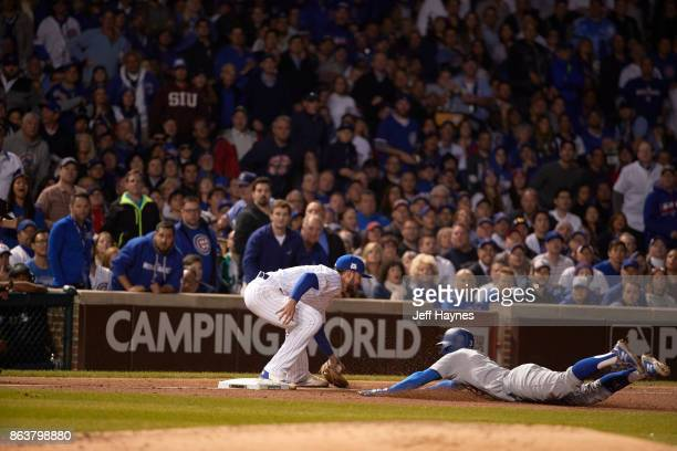 NLCS Playoffs Los Angeles Dodgers Chris Taylor in action sliding head first into third base vs Chicago Cubs Kris Bryant at Wrigley Field Game 3...