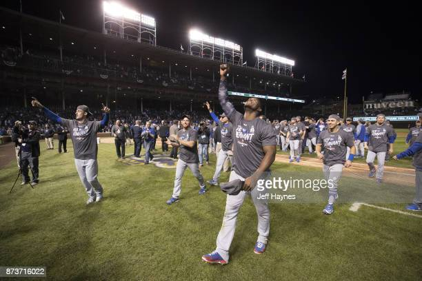 NLCS Playoffs Los Angeles Dodgers Cody Bellinger and Yasiel Puig victorious walking off field after winning game and series vs Chicago Cubs at...