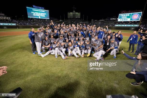 NLCS Playoffs Los Angeles Dodgers players victorious sitting on field after winning game and series vs Chicago Cubs at Wrigley Field Game 5 Chicago...