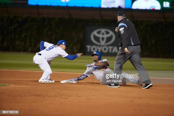 NLCS Playoffs Los Angeles Dodgers Yasiel Puig and Chicago Cubs Javier Baez pointing at each other at second base during game at Wrigley Field Game 3...