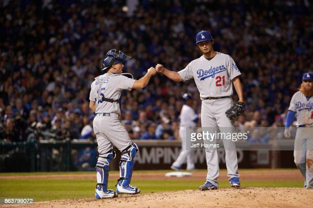 NLCS Playoffs Los Angeles Dodgers Yu Darvish victorious fist pump with Austin Barnes during game vs Chicago Cubs at Wrigley Field Game 3 Chicago IL...