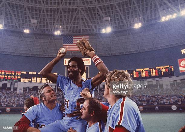 Baseball NLCS Playoffs Philadelphia Phillies Garry Maddox victorious getting carried off field by manager Dallas Green and team after winning Game 5...