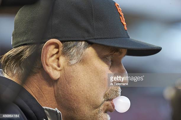 NLDS Playoffs Closeup of San Francisco Giants manager Bruce Bochy blowing bubble gum during game vs San Francisco Giants at Nationals Park Washington...