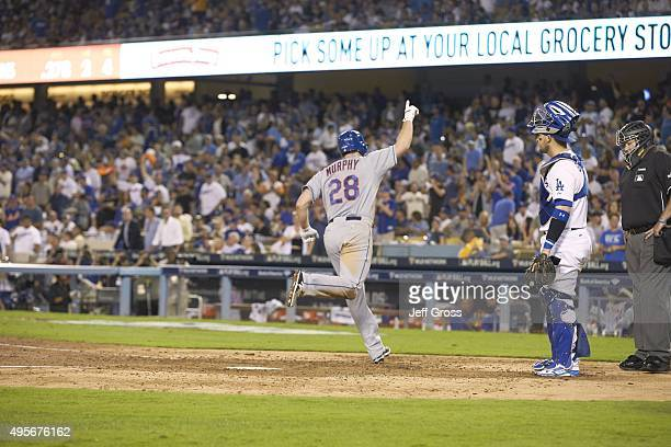 NLDS Playoffs Rear view of New York Mets Daniel Murphy victorious after hitting home run vs Los Angeles Dodgers at Dodger Stadium Game 5 Los Angeles...