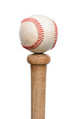 A used baseball resting on the knob end of a wood bat. Vertical format isolated on white.