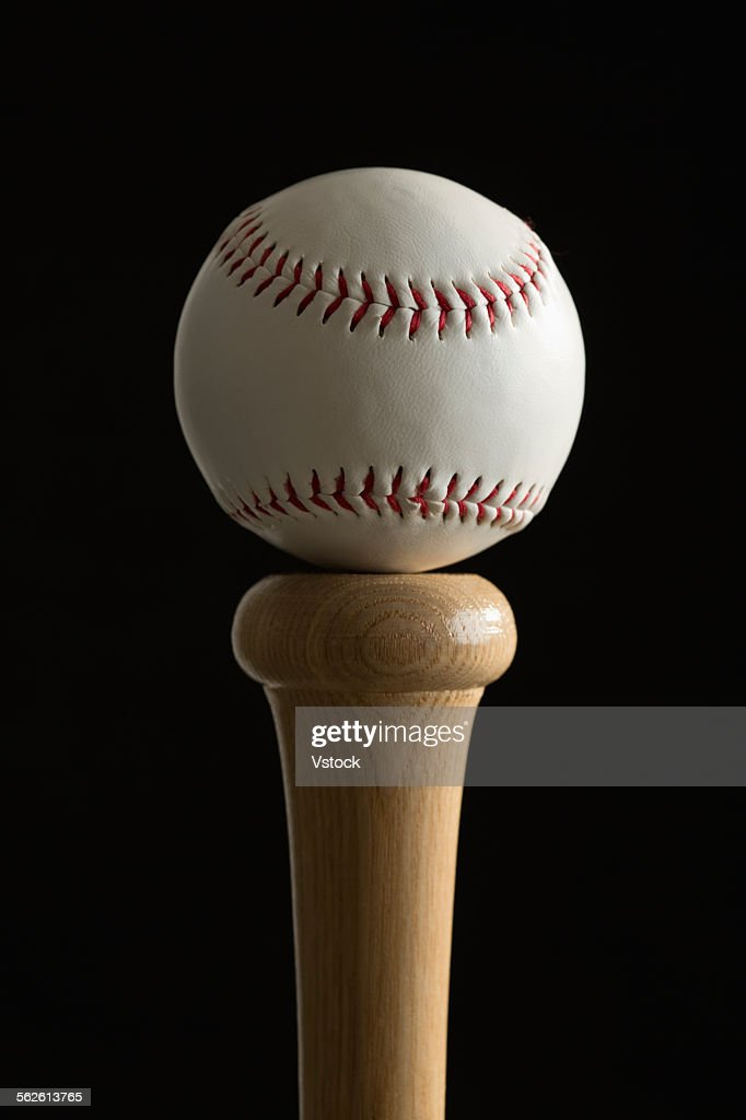 Baseball on top of bat