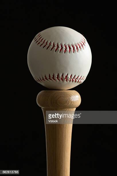 Baseball on top of bat
