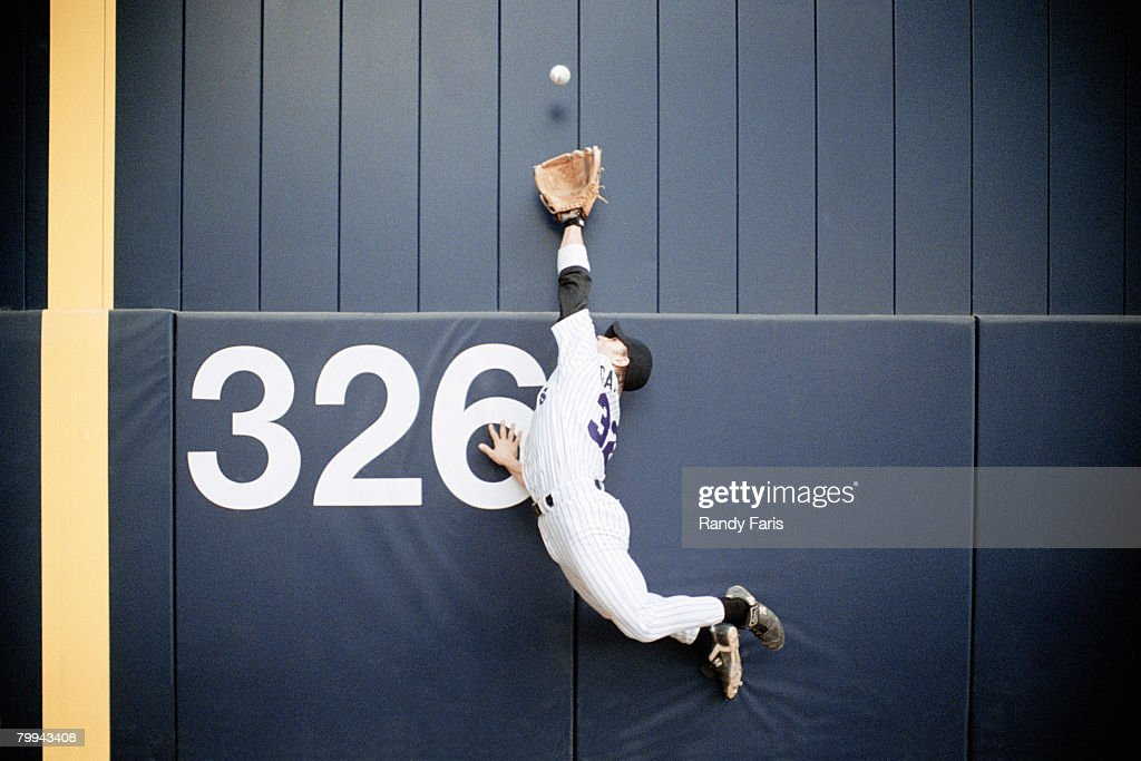 Baseball Outfielder Leaping for Fly Ball : Stock Photo