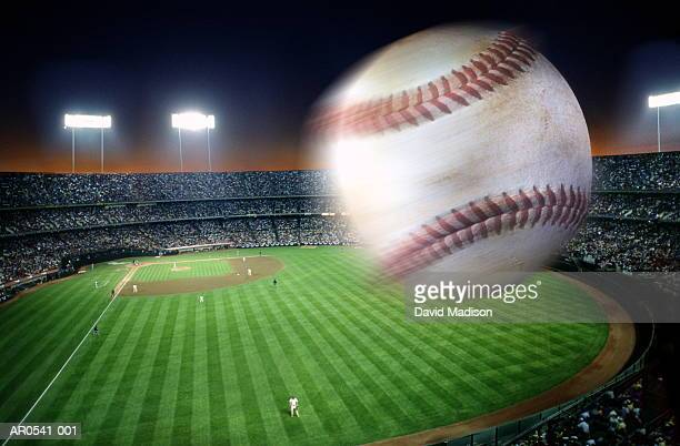 Baseball over stadium, blurred motion (Digital Composite)