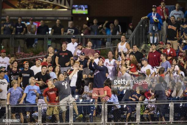 Overall view of fans in outfield catching home run ball during Philadelphia Phillies vs Houston Astros at Citizens Bank Park Philadelphia PA CREDIT...