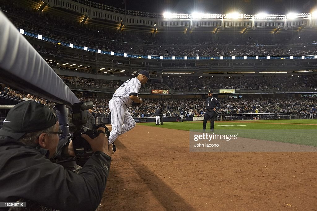 Overall view of New York Yankees Mariano Rivera (42) exiting dugout onto field during game vs Tampa Bay Rays at Yankee Stadium. Final home game of Rivera's career. John Iacono F2 )