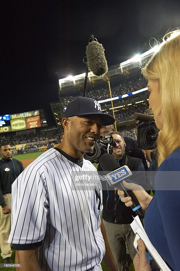 Overall view of New York Yankees Mariano Rivera (42) speaking with YES Network clubhouse reporter Meredith Marakovits during media interview after game vs Tampa Bay Rays at Yankee Stadium. Final home game of Rivera's career. John Iacono F9 )