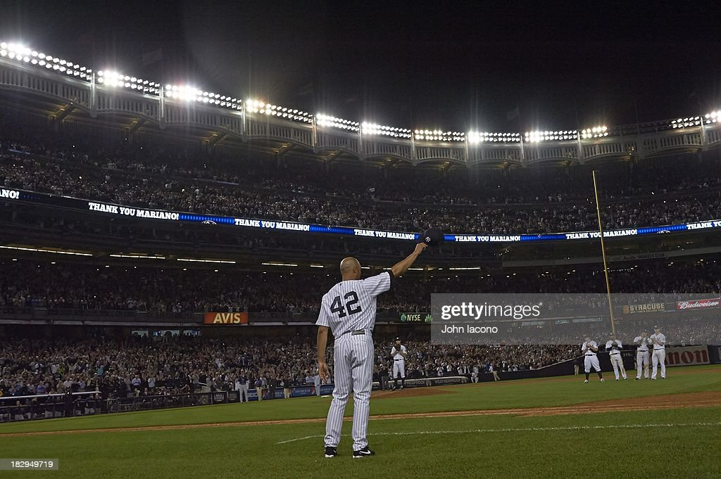Overall view of New York Yankees Mariano Rivera (42) acknowledging the crowd after leaving game vs Tampa Bay Rays at Yankee Stadium. Final home game of Rivera's career. John Iacono F5 )