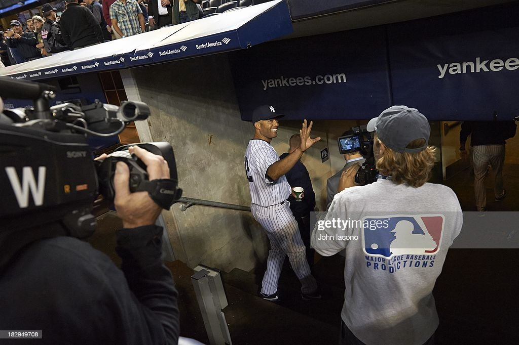 Overall view of New York Yankees Mariano Rivera (42) waving to fans and photographers after leaving game vs Tampa Bay Rays at Yankee Stadium. Final home game of Rivera's career. John Iacono F11 )
