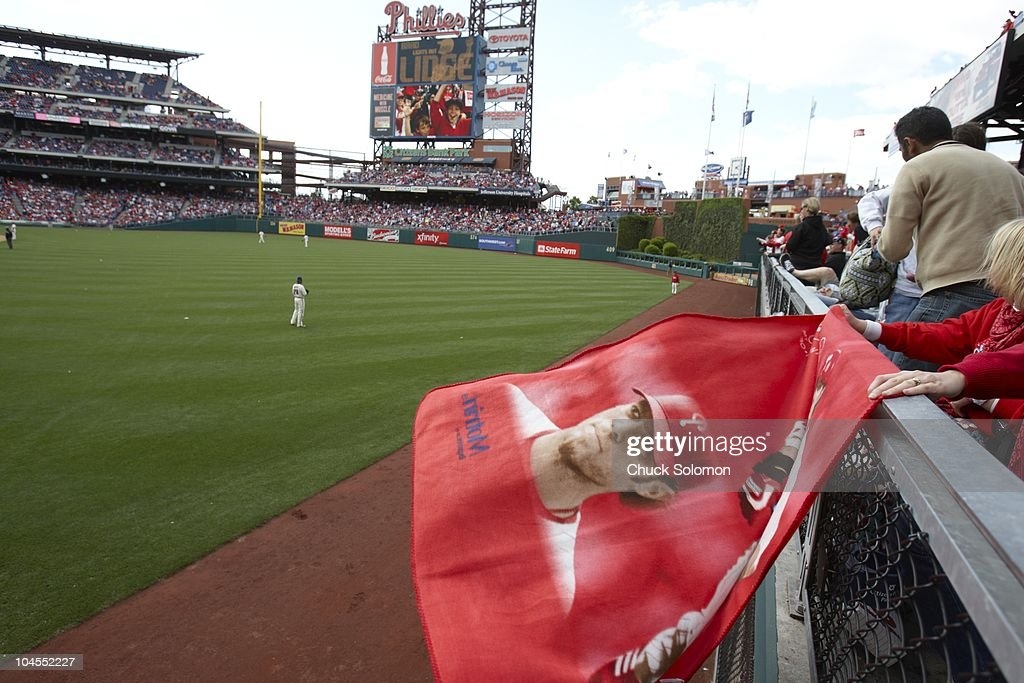 Philadelphia Phillies Jayson Werth (28) in outfield while fans wave Werth flag from stands during game vs Atlanta Braves. Philadelphia, PA 5/9/2010