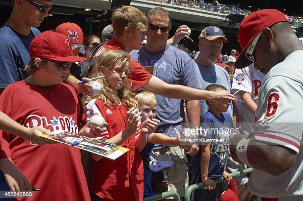 Philadelphia Phillies Ryan Howard signing autographs for fans before game vs Milwaukee Brewers at Miller Park Milwaukee WI CREDIT Heinz Kluetmeier