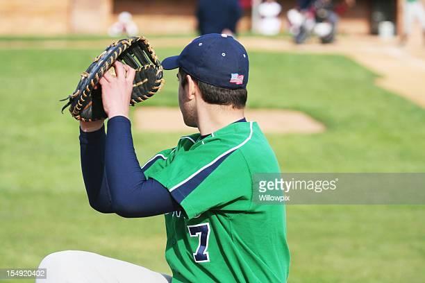 Baseball Pitcher Left Handed Youth Warming Up on Sideline