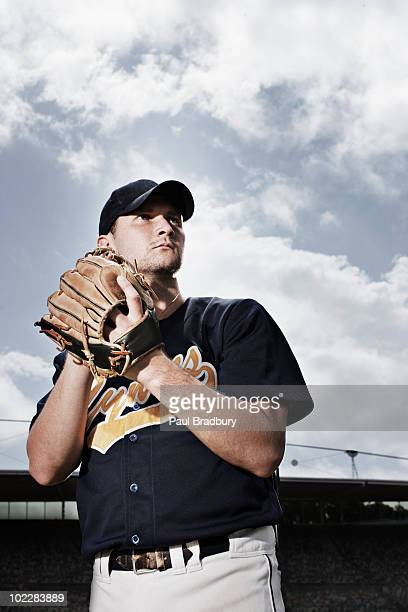 Baseball pitcher preparing to throw ball
