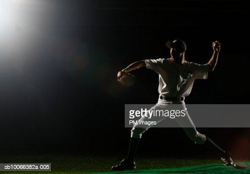 Baseball pitcher releasing ball