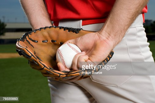 Baseball pitcher with glove and ball
