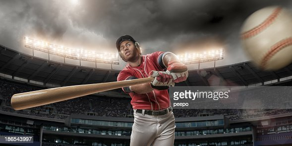 Baseball Player About To Hit Baseball
