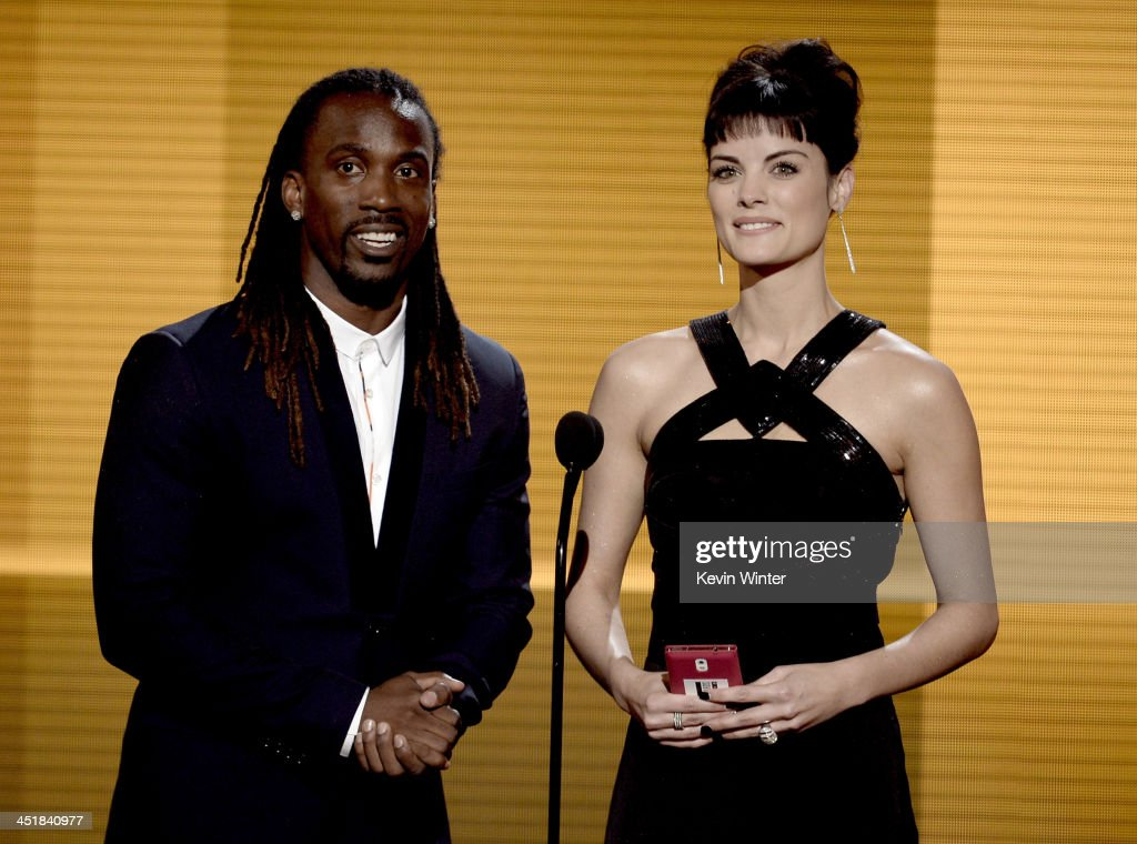 Baseball player <a gi-track='captionPersonalityLinkClicked' href=/galleries/search?phrase=Andrew+McCutchen&family=editorial&specificpeople=2364814 ng-click='$event.stopPropagation()'>Andrew McCutchen</a> and actress <a gi-track='captionPersonalityLinkClicked' href=/galleries/search?phrase=Jaimie+Alexander&family=editorial&specificpeople=544496 ng-click='$event.stopPropagation()'>Jaimie Alexander</a> speak onstage during the 2013 American Music Awards at Nokia Theatre L.A. Live on November 24, 2013 in Los Angeles, California.