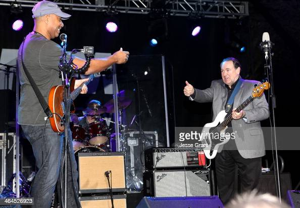 Baseball player Bernie Williams and former Arkansas Governor Mike Huckabee at the 2014 National Association of Music Merchants show block party at...