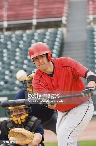 Baseball player bunting the ball