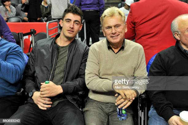 Baseball player Cody Bellinger and TV personality Pat Sajak attend a basketball game between the Los Angeles Clippers and the Los Angeles Lakers at...