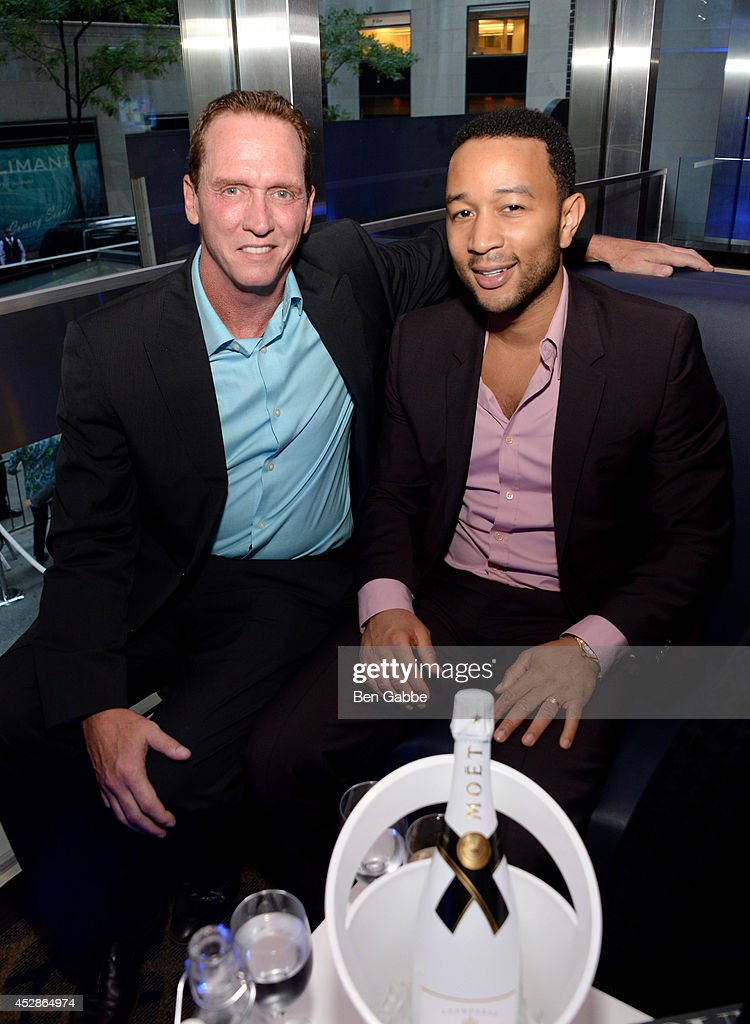 Baseball player David Cone (L) and singer-songwriter John Legend attends DuJour Magazine and NYY Steak celebrating Chrissy Teigen with FENDI timepieces and Moet Ice on July 28, 2014 in New York City.