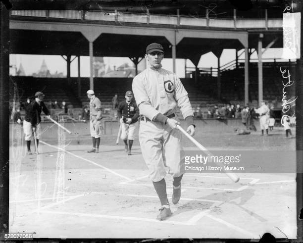 Baseball player Frank Schulte of the Chicago Cubs holds a bat near home plate on the field at West Side Grounds Chicago Illinois 1909