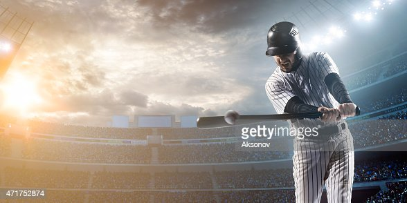 Baseball player hitting a ball in stadium