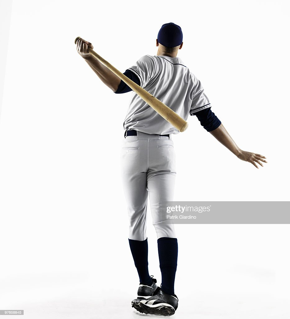 Baseball Player hitting home run from behind : Stock Photo