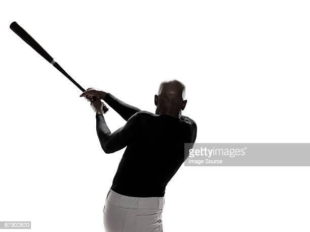 A baseball player holding a bat