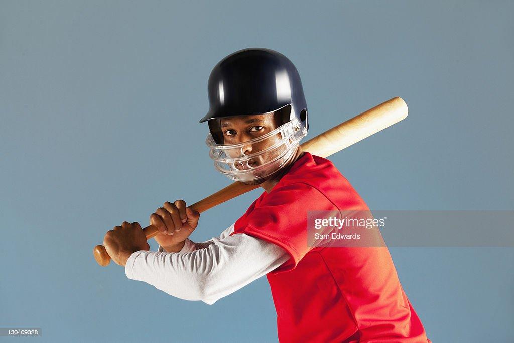 Baseball player holding bat : Stock Photo