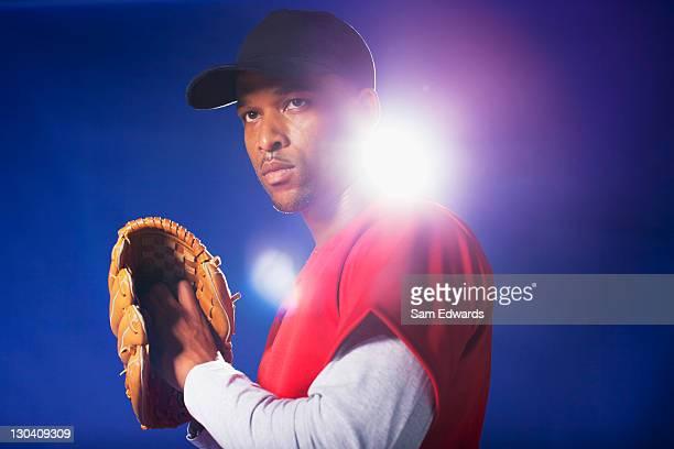 Baseball player holding glove
