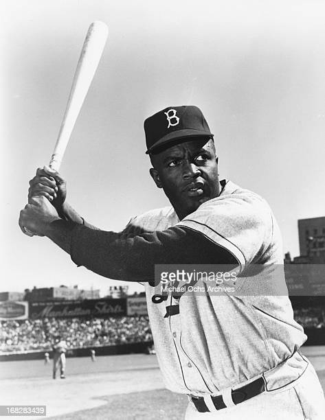 Baseball player Jackie Robinson poses for a portrait on the field at a ball game in circa 1950 in New York New York