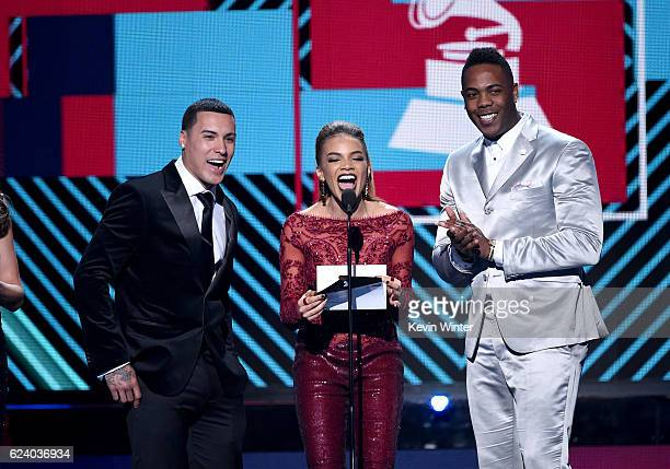 Baseball player Javier Baez singer Leslie Grace and baseball player Aroldis Chapman speak onstage during The 17th Annual Latin Grammy Awards at...