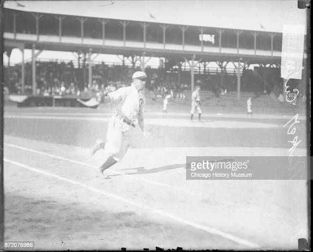 Baseball player Joe Tinker of the Chicago Cubs approaches first base during a game at West Side Grounds Chicago Illinois 1908