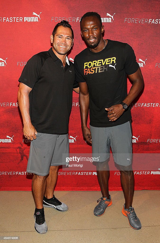 Baseball player Johnny Damon (L) and Olympic sprinter Usain Bolt pose for a photo at The PUMA Store In Soho Forever Faster Training Event on September 3, 2014 in New York City.