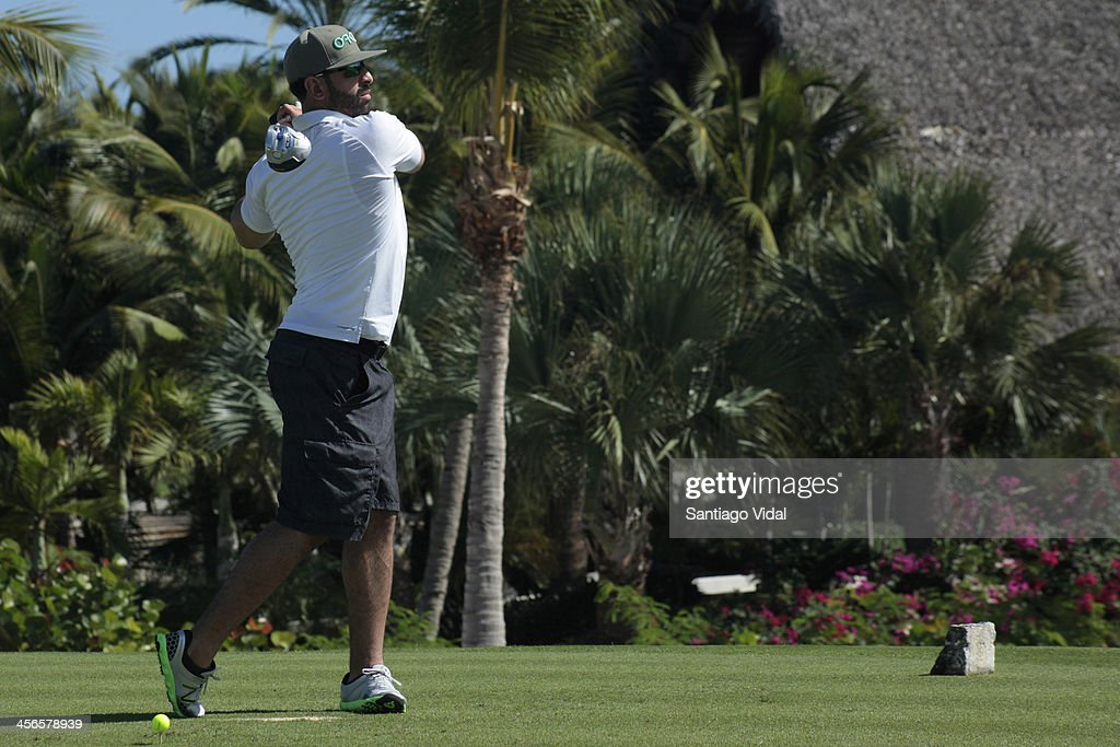 Baseball player Jose Bautista in action during the David Ortiz 6th Celebrity Golf Classic at Punta Espada Golf Club on December 14, 2013 in Punta Cana, Dominican Republic.