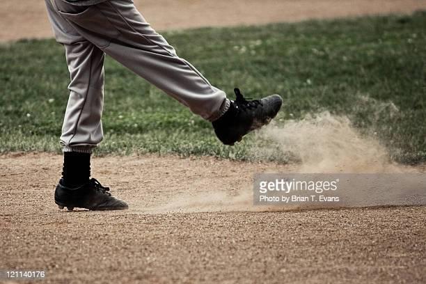 Baseball player kicks up