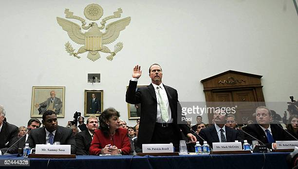 Baseball player Mark McGwire is sworn in as Sammy Sosa and Rafael Palmeiro and Curt Schilling look on March 17 2005 during a House committee that is...